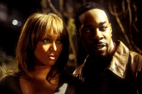 Tyra Banks and Busta Rhymes in Dimension's Halloween: Resurrection - 2002