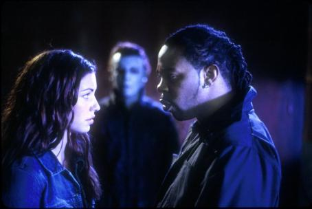 Bianca Kajlich  and Busta Rhymes are stalked by Michael Myers in Dimension's Halloween: Resurrection - 2002