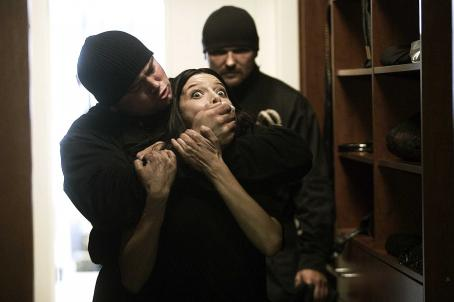 Lauren German Beth () gets grabbed from behind in HOSTEL: PART II. Photo credit: Rico Torres.