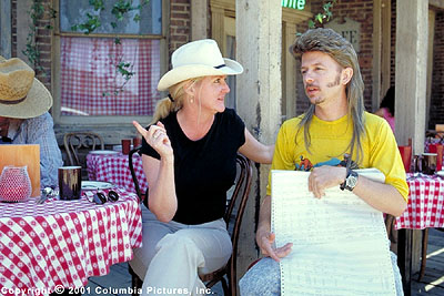 Joe Dirt Director Dennie Gordon (left) and star David Spade discuss a scene during the filming of the Columbia Pictures presentation,  - 2001