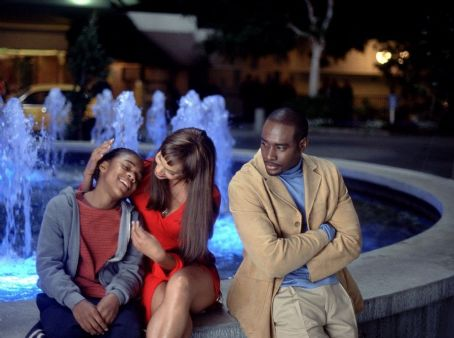 Morris Chestnut Calvin (Lil Bow Wow) enjoys the attentions of a reporter, Janet (Sandra Prosper), while Tracy (), Janet's unhappy, would-be suitor, looks on in 20th Century Fox's Like Mike - 2002