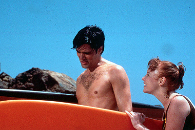 Thomas Gibson  as Kanaka and Lauren Ambrose as Chicklet in Strand's Psycho Beach Party - 2000