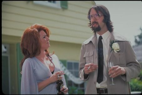 Megan Mullally  and Tom Green in Columbia's Stealing Harvard - 2002