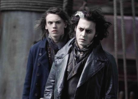 "Jamie Campbell Bower Anthony (, left), a young sailor who rescued Sweeney Todd, tells Sweeney (Johnny Depp, right) about a plan to rescue his daughter Johanna from the clutches of Judge Turpin in ""Sweeney Todd: The Demon Barber of Fleet Street.&#8221"