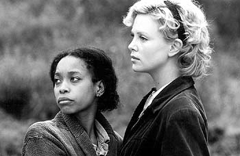 Erykah Badu  and Charlize Theron in Miramax's The Cider House Rules - 12/99
