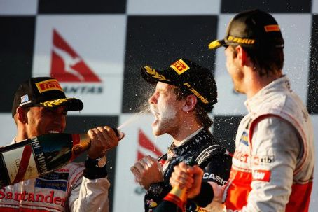 Third placed Lewis Hamilton of Great Britain and McLaren sprays second placed Sebastian Vettel of Germany and Red Bull Racing on the podium following the Australian Formula One Grand Prix at the Albert Park circuit on March 18, 2012 in Melbourne, Australi