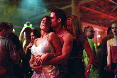 The In Crowd Brittany (Susan Ward) and Adrien (Lori Heuring) dance with a dude in Warner Brothers'  - 2000