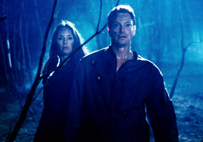 Impostor Madeleine Stowe and Gary Sinise in Dimension's  - 2002