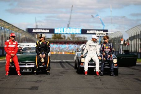 (L-R) Fernando Alonso of Spain and Ferrari, Kimi Raikkonen of Finland and Lotus, Michael Schumacher of Germany and Mercedes GP, and Sebastian Vettel of Germany and Red Bull Racing, four of the six F1 World Champions in this years field pose on the grid be