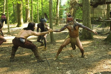 "Raoul Trujillo (left to right) Colin Farrell as ""Captain John Smith"" and  as ""Tomocomo"" in a game of strength in New Line Cinema's upcoming film, The New World. The epic adventure is set amid the encounter of European and Nati"