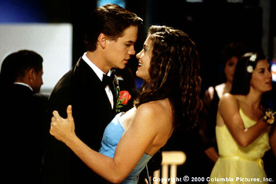 Whatever It Takes Formerly one of the high school uncool, Ryan Woodman (Shane West) gets tight with the popular crowd when he wins the heart of knockout Ashley Grant (Jodi Lyn O'Keefe) in Columbia/Phoenix's  - 3/2000