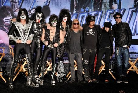 (L-R) Musicians Gene Simmons, Tommy Thayer, Eric Singer, Paul Stanley, Vince Neil, Nikki Sixx, Mick Mars and Tommy Lee appear onstage to announce their upcoming Motley Crue and KISS co-headlining tour at the Hollywood Roosevelt Hotel on March 20, 2012 in