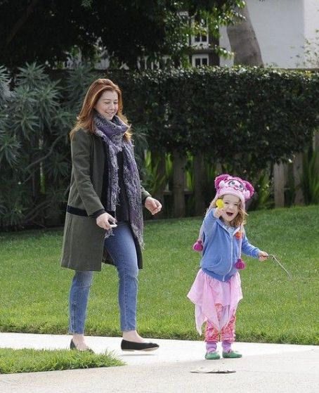 Alyson Hannigan takes Satyana out for a walk
