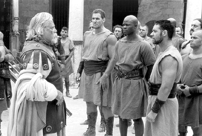 Oliver Reed Proximo (), Hagen (Ralf Moeller), Juba (Djimon Hounsou) and Maximus (Russell Crowe) in Dreamworks' Gladiator - 5/2000