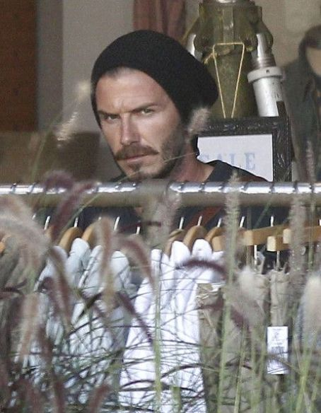 David Beckham out doing some shopping and cruising his motorcycle on Melrose Ave in West Hollywood, California on July 2, 2012