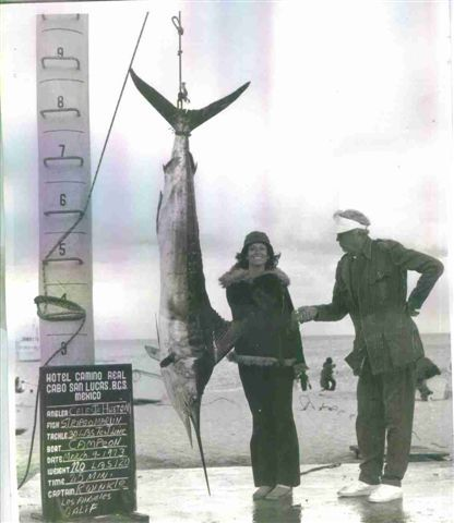 Catch of the day - Celeste's first marlin. Celeste & John Huston, fishing in Mexico.