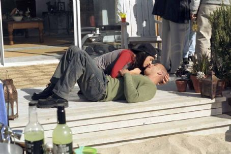 Jacqueline Obradors (left to right) Stacey Vetter () and her husband Sean (Vin Diesel) share a moment during a cookout in New Line Cinema's action drama, A Man Apart.