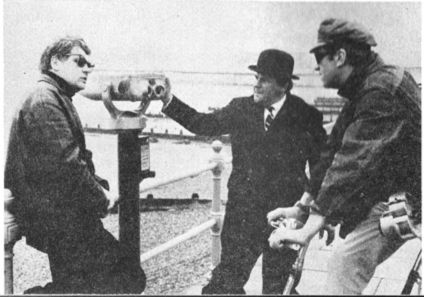 Ken Russell James Booth and Roy Kinnear in discussion with director  on set of 'French Dressing' at Herne Bay 1963
