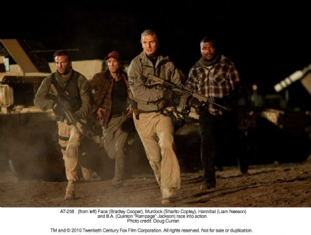 Quinton 'Rampage' Jackson - (from left) Face (Bradley Cooper), Murdock (Sharlto Copley), Hannibal (Liam Neeson) and B.A. (Quinton 'Rampage' Jackson) race into action. Photo credit: Doug Curran