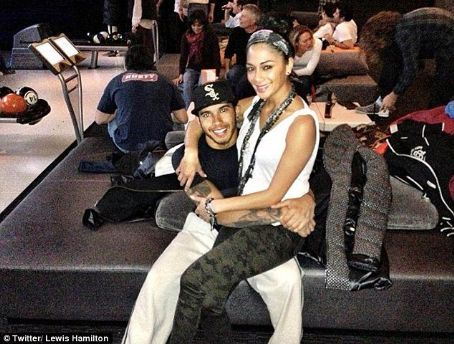 She's bowled over! Nicole Scherzinger cuddles up to beau Lewis Hamilton in cute snap as they enjoy a date bowling