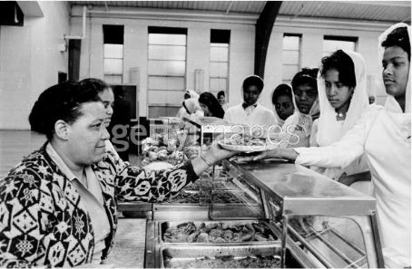 Khalilah 'Belinda' Ali Khalilah Ali (far right) is served lunch with fellow graduates after graduation ceremonies at the Nation of Islam's University of Islam Temple #2, Chicago, IL, 1965. The former Belinda Boyd took the name Khalilah Ali upon marrying the boxer Muhammad Ali.