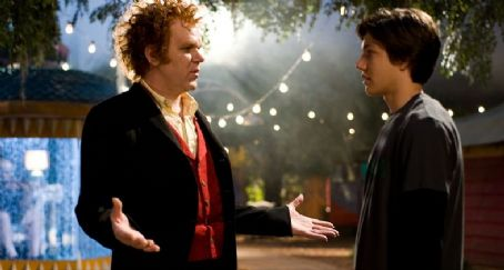 Cirque du Freak: The Vampire's Assistant Larten Crepsley (John C. Reilly) with Darren Shan (Chris Massoglia) in the scene of Cirque du Freak: The Vampire's Assistant.