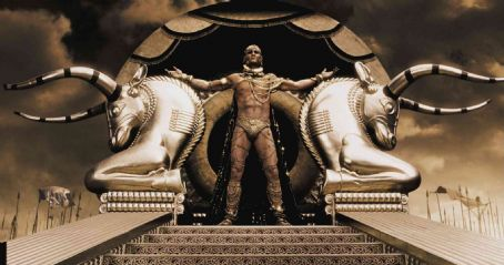 "Xerxes  (RODRIGO SANTORO), the Persian king who claims to be a god, stands atop his elaborate golden litter in Warner Bros. Pictures', Legendary Pictures' and Virtual Studios' action drama ""300,"" distributed by Warner Bros. Pi"