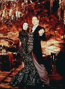 Morticia Addams Anjelica Huston and Raul Julia in  Addams Family Value (1993)