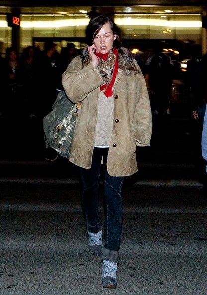 Milla Jovovich: arrives at LAX