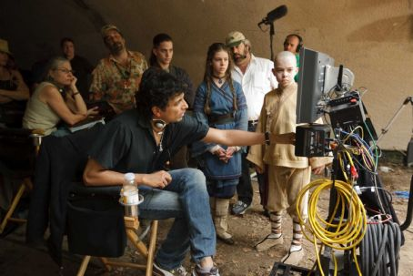 Noah Ringer Center left to right: Writer/Producer/Director M. Night Shyamalan confers with Jackson Rathbone (Sokka), Nicola Peltz (Katara), and  (Aang) on the set of Paramount Pictures/Nickelodeon Movies adventure, 'The Last Airbender.' Photo credi